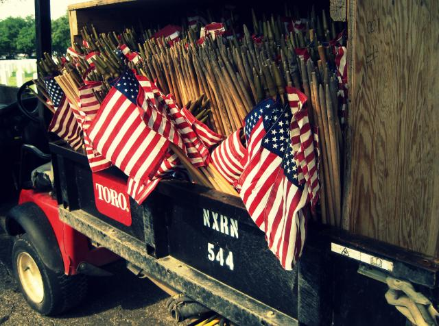 Flags ready to be placed on graves at Fort Sam Houston National Cemetery