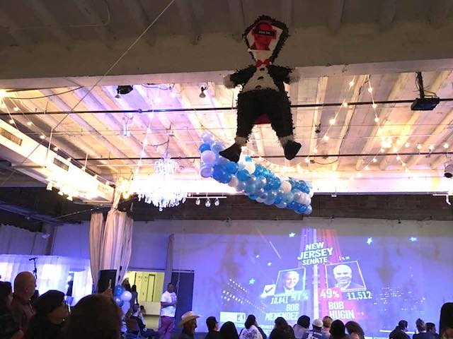Ted Cruz piñata in the rafters during Beto O'Rourke watch party at the Brick