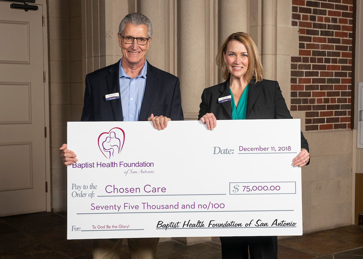Bob Buckley, Chosen board director, and Jenni Lord, Chosen executive director, accept a $75,000 check from Baptist Health Foundation