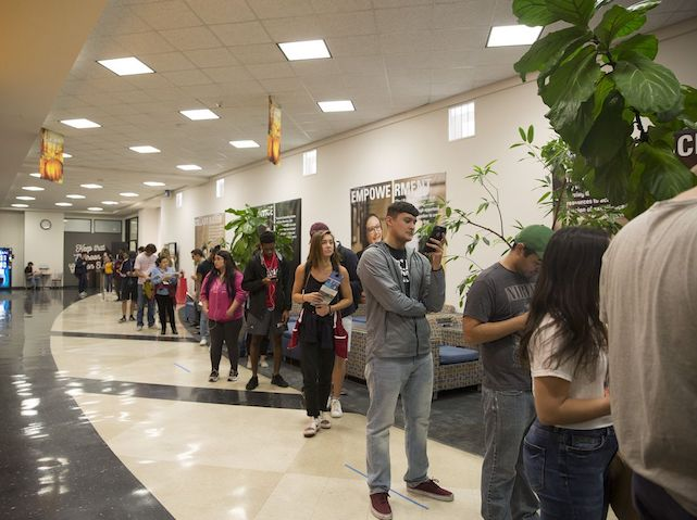 Students lined up to vote at Texas State University on Friday, Nov. 2, 2018. Photo by Mikala Compton for The Texas Tribune