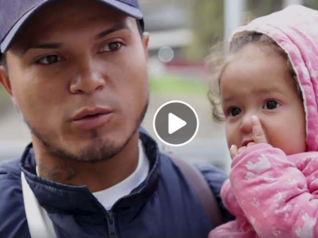 Central American father and toddler seeking asylum in the S.A.