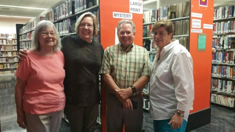 Pat Konstam with fellow former business editors in the library's BookCellar