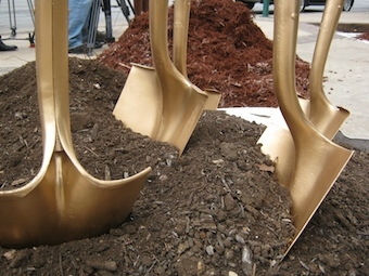 Mayor Julian Castro uses gold-painted shovels to plant oaks in downtown SA